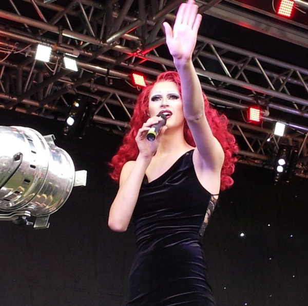 A singer performing at Pride main stage in 2014