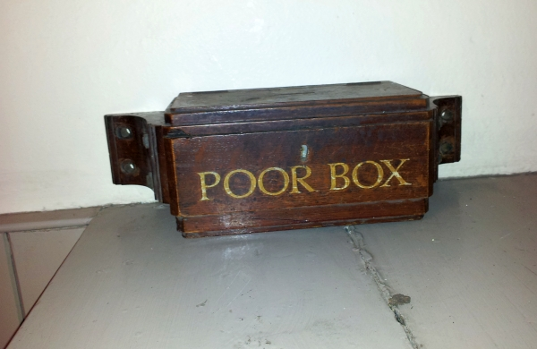 The poor box in the entrance hall