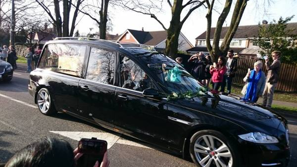 The hearse traveling through Leicester Forest East Photo by Kevin Gaughan