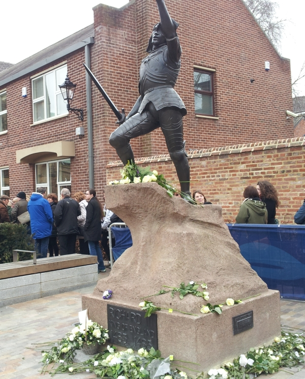 Richard's statue with white roses placed by the public